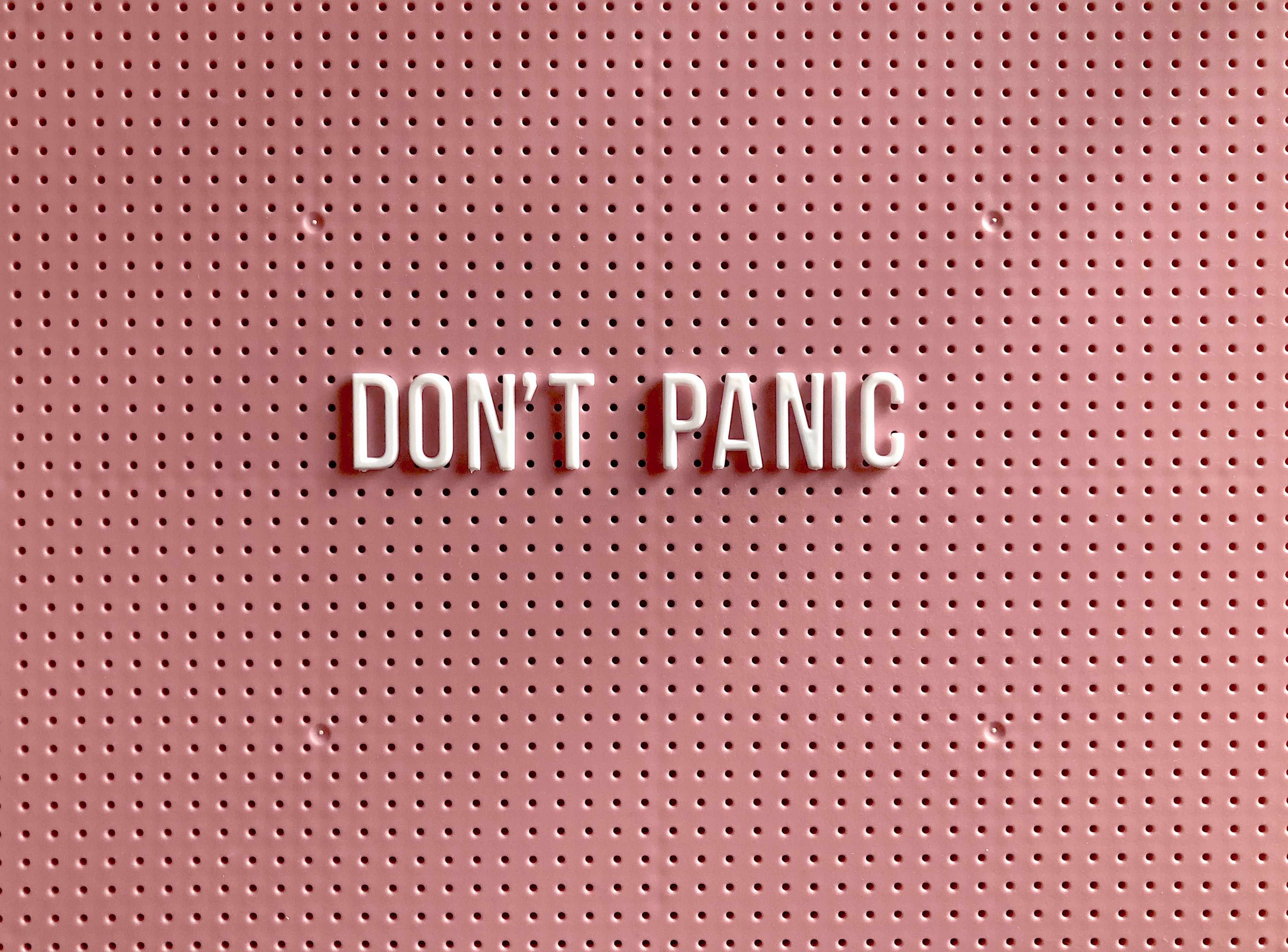 Don't Panic written on a board